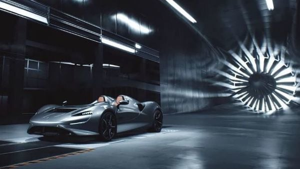McLaren Elva supercar packs a punch: 804 horsepower on a V8 engine and rear-wheel drive. McLaren had planned to build just 399 of them, each one customized and delivered at the end of 2020.  The company will finalize physical development once staff are back in the plants. (Photo grab of Elva from video posted on Youtube by McLaren Automotive.)