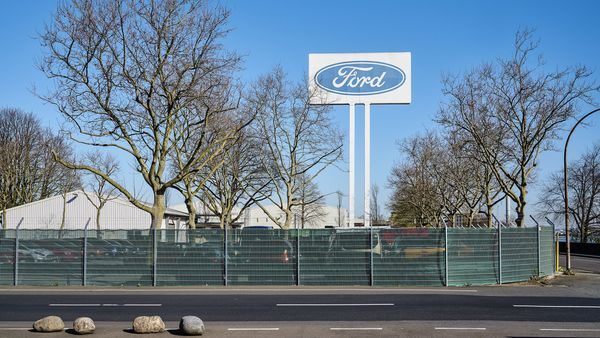 File photo: A Ford Motor Co. logo sits on display outside a Ford factory as coronavirus halts the automaker's German automobile assembly operations in Cologne, Germany. (Bloomberg)