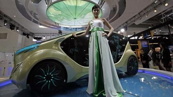 File photo of a model posing at the Beijing Auto Show in 2010. (REUTERS)