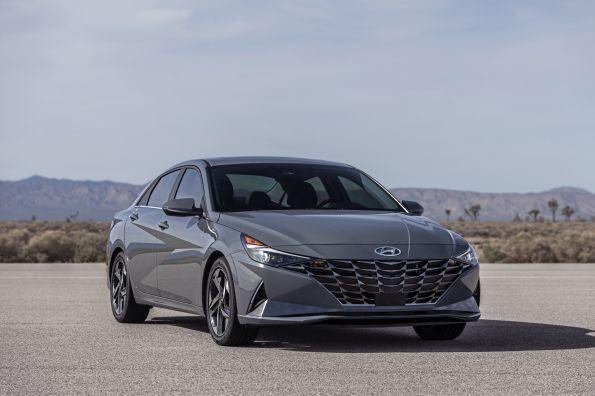 The 2021 Elantra Hybrid gets a large 'parametric-jewel-pattern' grille. Turn signal lights are integrated into the grille and are next to large headlights.