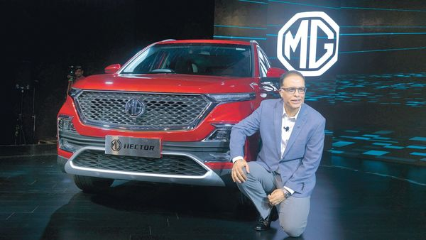 Rajeev Chaba, Managing Director, MG Motor India, posing with the Hector SUV.