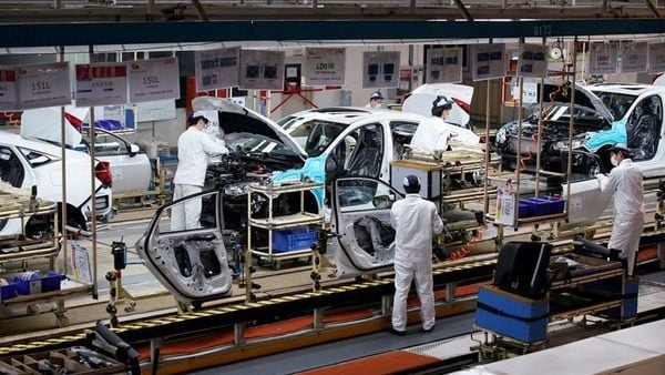 File photo: Employees work on a production line inside a Dongfeng Honda factory after lockdown measures in Wuhan, the capital of Hubei province and China's epicentre of the novel coronavirus disease outbreak, were further eased. (REUTERS)