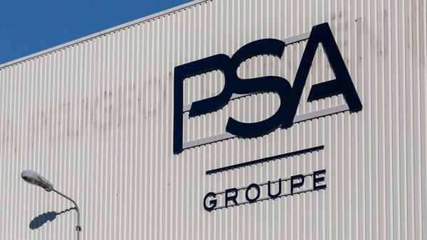 A logo sits on the exterior of the PSA Group automobile factory in Poissy, France. Photo used for representational purpose only. (Bloomberg)