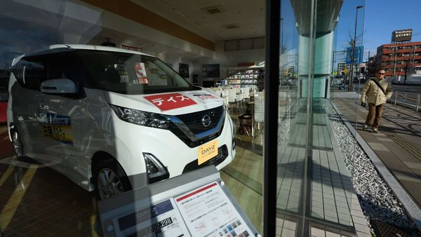 A Nissan Motor Co. Dayz vehicle stands on display ins the window of a dealership in Yokohama, Kanagawa Prefecture, Japan. (Bloomberg)