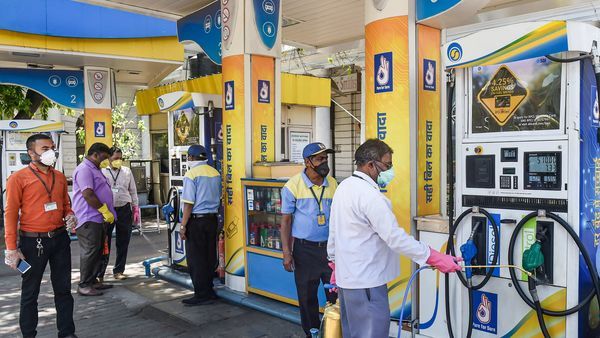 NDMC workers spray disinfectant at a Petrol Pump in Connaught Place during the nationwide lockdown in the wake of coronavirus pandemic in New Delhi. (PTI)