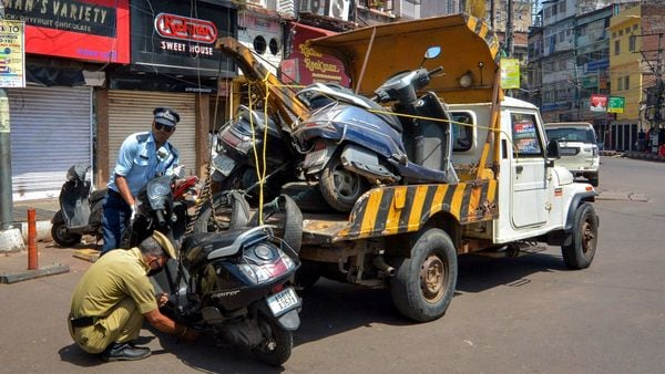 Guwahati Police officials seize vehicles of commuters who were flouting lockdown, imposed in the wake of coronavirus pandemic. (PTI)