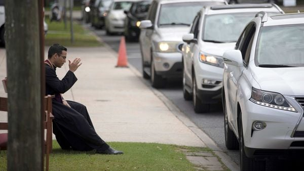 A drive-by confession in progress. (REUTERS)