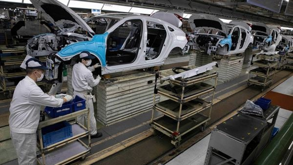Workers assemble cars at the Dongfeng Honda Automobile Co., Ltd factory in Wuhan in central China's Hubei province. (AP)