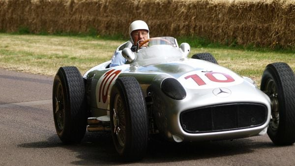 In this file photo taken on July 5, 2009 Britain's Stirling Moss drives his 1954 Mercedes Benz W196 racing car in England. (AFP)