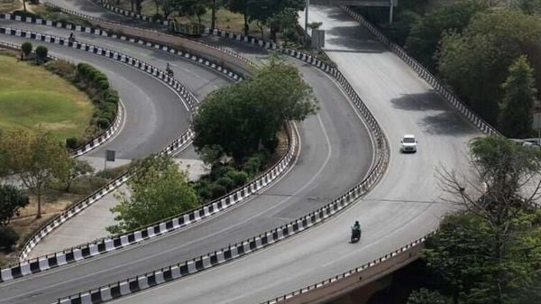 Vehicles drive on a nearly empty road after India extended a nationwide lockdown to slow the spreading of coronavirus disease (COVID-19), in New Delhi. (REUTERS)