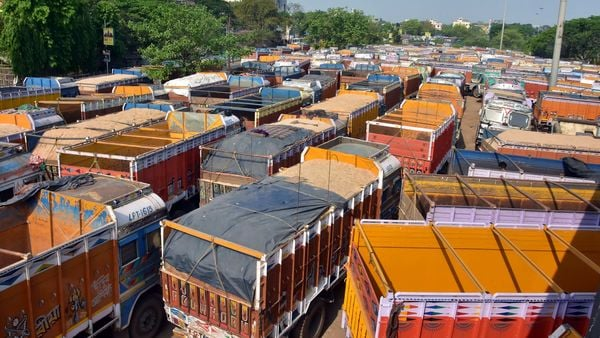 Trucks are seen parked during the nationwide lockdown amid coronavirus pandemic, in Kolkata.