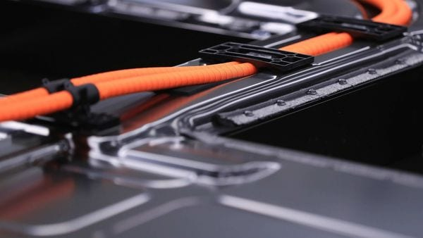 An electric cable runs along the lithium-ion battery of an all-electric Porsche AG Taycan luxury automobile on the production line inside the Porsche AG factory in Stuttgart, Germany. (This is a file photo used for representational purpose only.) (Bloomberg)