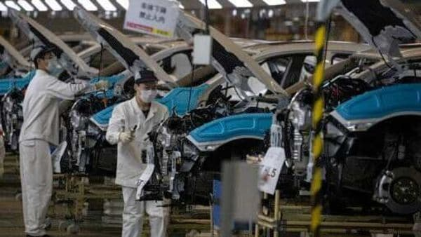 In this April 8, 2020, photo, employees work on a car assembly line at the Dongfeng Honda Automobile Co., Ltd factory in Wuhan in central China's Hubei province. (AP)
