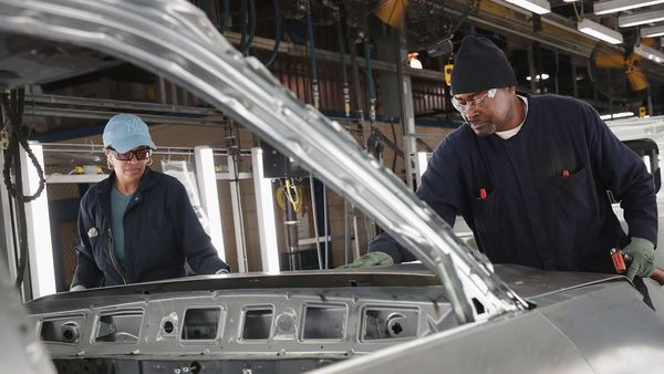 File photo of Ford workers assemble vehicles at the Chicago Assembly Plant. (AFP)