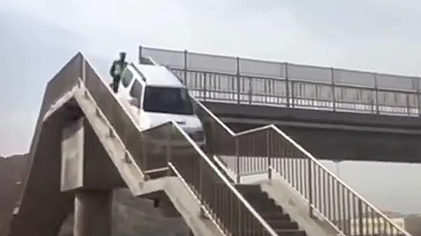 A Suzuki Jimny uses the subway to cross the road. (Photo courtesy: YouTube/South China Morning Post)