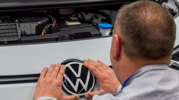 File photo: An employee fixes a VW badge at a production line for the electric Volkswagen model ID.3 in Zwickau, Germany. (REUTERS)