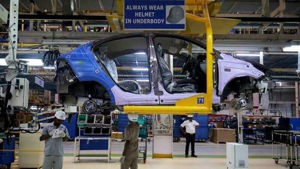 File photo of workers assemble a Tata Tigor car inside the Tata Motors car plant in Sanand. (REUTERS)
