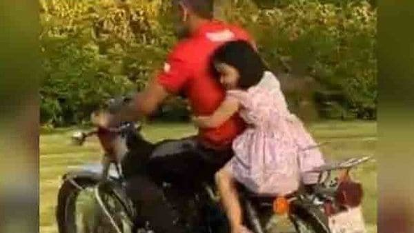 MS Dhoni riding bike with his daughter Ziva