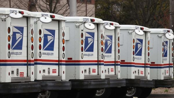 A general view of United States Postal Service trucks on April 12, 2020 in Farmingdale, New York. (AFP)