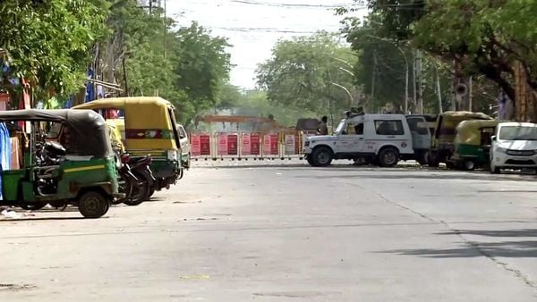 Police personnel deployed the area which has been identified as a containment zone, during the nationwide lockdown to curb the spread of coronavirus in Noida.