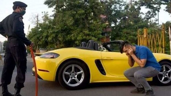 Man made to do sit ups for driving a Porsche 718 Boxster and not wearing a mask amidst lockdown.