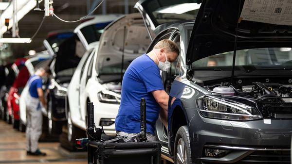 A worker wears a protective mask at the Volkswagen assembly line after VW re-starts Europe's largest car factory after coronavirus shutdown in Wolfsburg, Germany, April 27, 2020, as the spread of the coronavirus disease (COVID-19) continues. Swen Pfoertner/Pool via REUTERS (REUTERS)