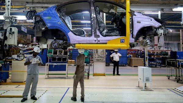 FILE PHOTO: Workers assemble a Tata Tigor car inside the Tata Motors car plant in Sanand, on the outskirts of Ahmedabad, India (REUTERS)