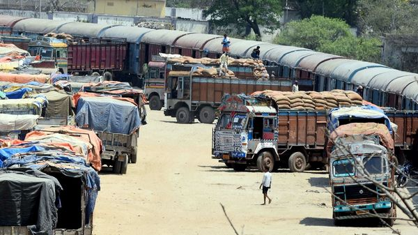 Workers unloading sacks from a goods train to the trucks to maintain the supply chain of the food and essential goods during the nationwide lockdown in Jharkhand.