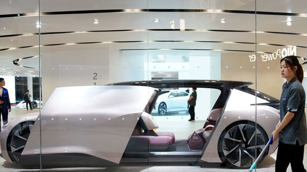 FILE PHOTO: Cleaners are seen next to a self-driving electric concept car NIO Eve displayed at the second media day for the Shanghai auto show in Shanghai, China April 17, 2019. REUTERS/Aly Song/File Photo (REUTERS)