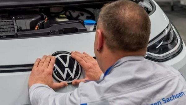 File Photo: An employee fixes a VW badge at a production line for the electric Volkswagen model ID.3 in Zwickau, Germany. (Representational Image) (REUTERS)