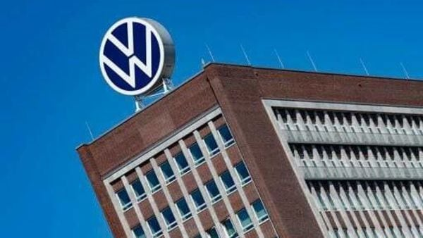 FILE - In this Monday, April 27, 2020. file photo, The Volkswagen logo stand on the top of a VW headquarters building in Wolfsburg, Germany. Volkswagen is gradually launch the production at important plants after the corona lockdown. (Swen Pfoertner/dpa via AP) (AP)