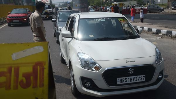 Vehicles are stopped at the state border to cross to Delhi after Haryana government sealed its border with the national capital. (AFP)