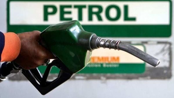 FILE PHOTO: An attendant holds a petrol nozzle at a petrol pump. (REUTERS)