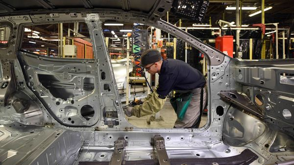 File photo: Nissan's manufacturing staff works on the 'Metal Line' in the Body Shop of their Sunderland Plant in Sunderland, North East England on November 12, 2014. Car giant Nissan announced a halt in production on March 17, 2020 at its Sunderland factory because of falling demand amid the coronavirus outbreak. (AFP)