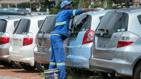 A worker photographed while he washes cars. (Representational File Photo) (AP)