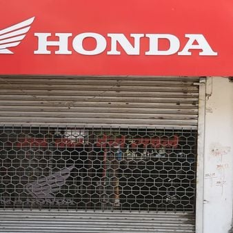 File photo: A Honda two-wheelers shop is closed during a government-imposed nationwide lockdown as a preventive measure against the Covid-19 in New Delhi. (AFP)