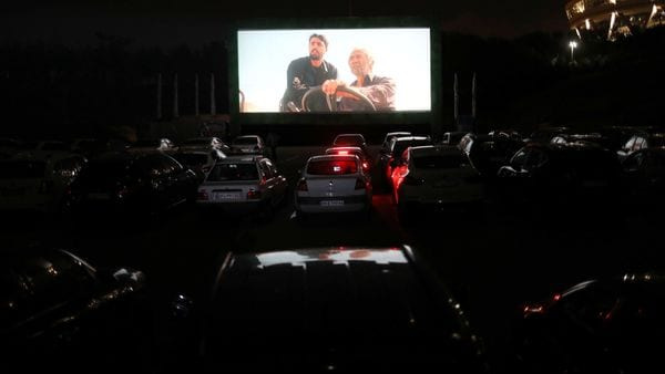 File photo: People sit in their cars watching a movie in a drive-in cinema at the Milad Tower parking space, following the outbreak of the coronavirus disease in Tehran, Iran. (VIA REUTERS)