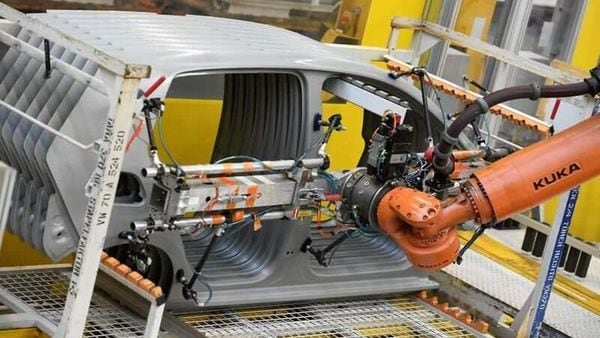 A robot moves car components in a production line at the Volkswagen plant in Wolfsburg, Germany March 1, 2019. (REUTERS)