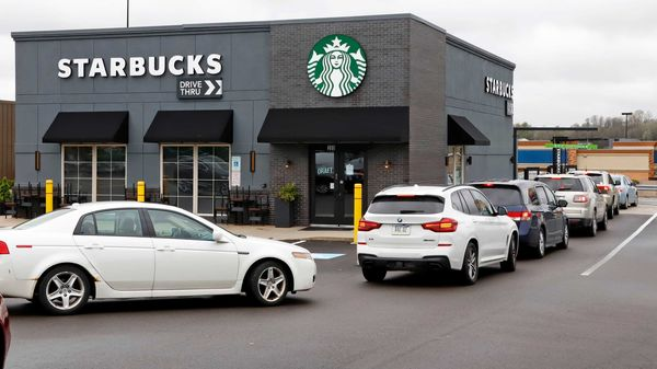 Restaurants continue to keep their dining rooms closed due to the coronavirus pandemic. But drive-through pick up windows are helping maintain social distancing. Here, cars line up in the drive-through of a Starbucks in Robinson Township, Pennsylvania.