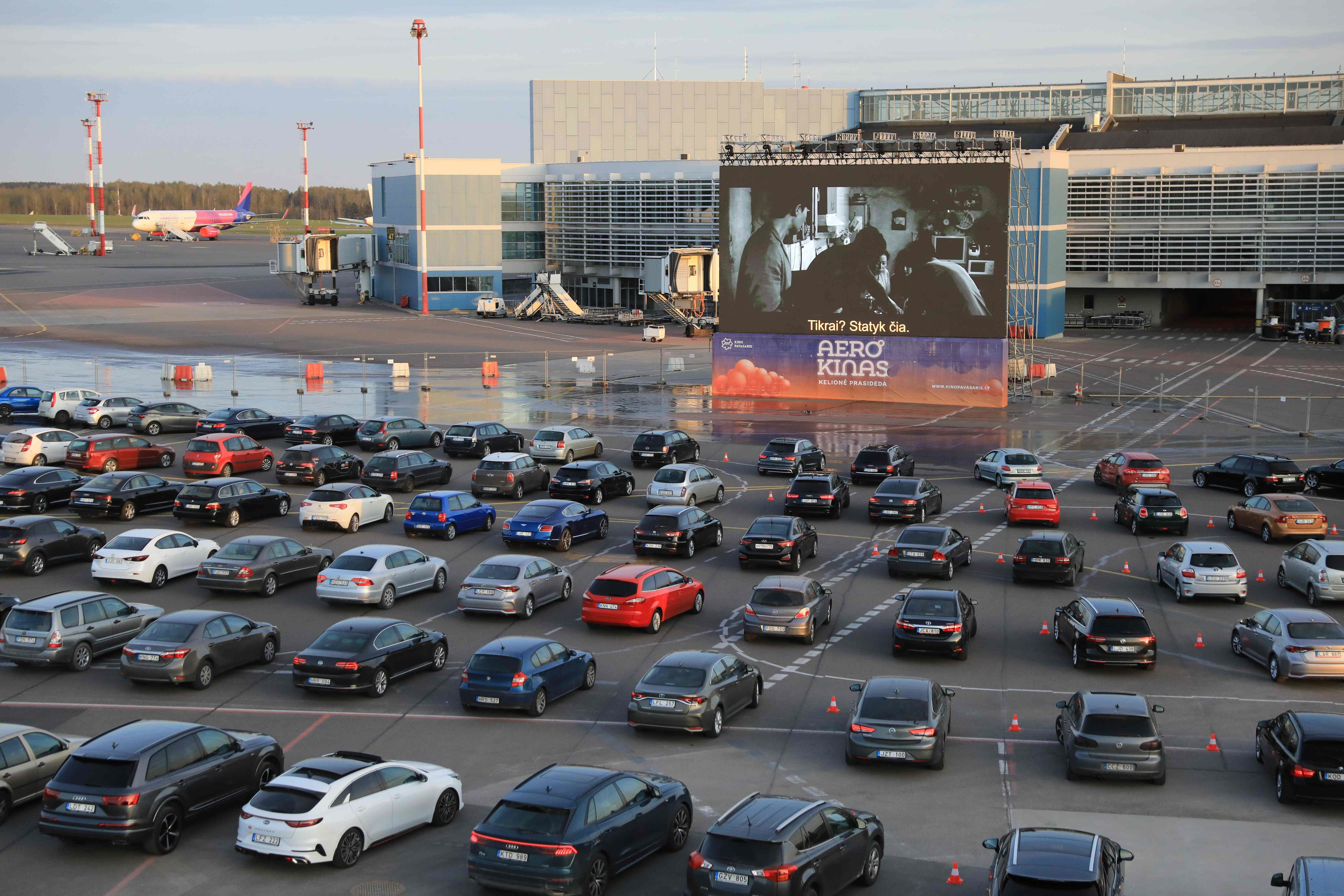 In this makeshift drive-in cinema at the airport in Vilnius, Lithuania, people sit in their cars watching Oscar-winning South Korean film Parasite. While movie theatres and airport operations remain shut due to coronavirus, this is the best arrangement to beat the blues.