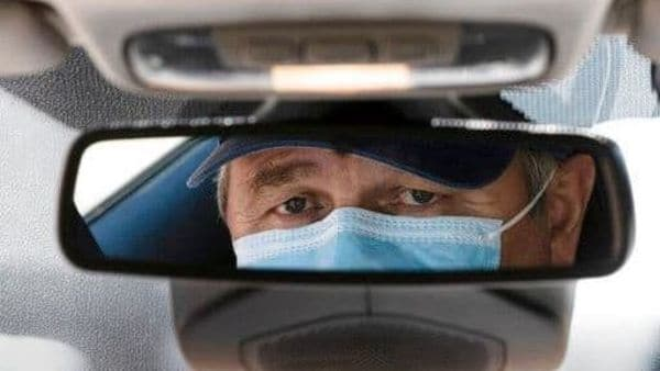 Lyft will require both passengers and drivers to wear masks and complete a health certification program. (AP)