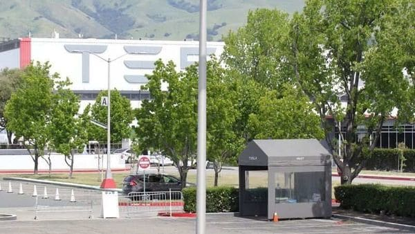Tesla's only US vehicle factory in Fremont, California awaits restart order. (REUTERS)