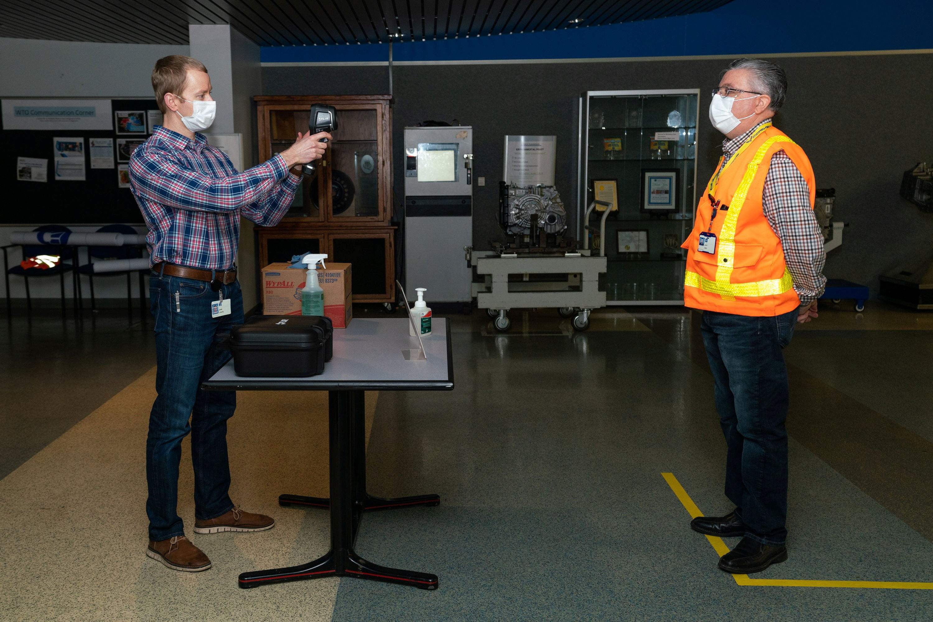 As General Motors prepares to resume production at its plants in the US, an employee tests a fever-scanning thermal camera at a facility in Warren, Michigan, as part of a new procedure for employees entering the factories. (VIA REUTERS)