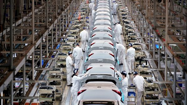 FILE PHOTO: Employees work on a production line inside a Dongfeng Honda factory after lockdown measures in Wuhan, the capital of Hubei province and China's epicentre of the novel coronavirus disease outbreak, were further eased, (REUTERS)