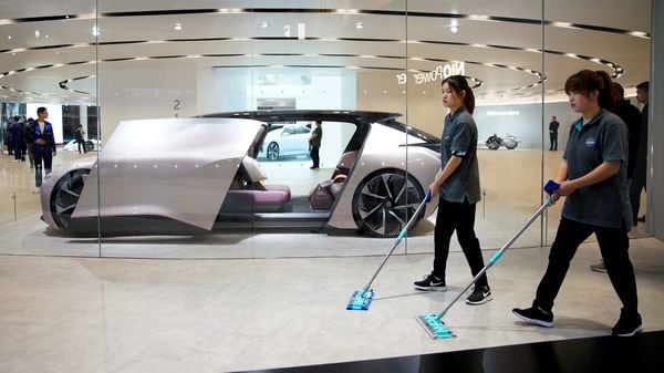 Cleaners are seen next to a self-driving electric concept car NIO Eve displayed. (File photo) (REUTERS)