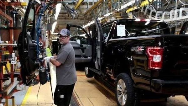 A Ford Motor assembly worker works on a 2018 Ford F150 pick-up truck at Ford's Dearborn Truck Plant. (File photo) (REUTERS)