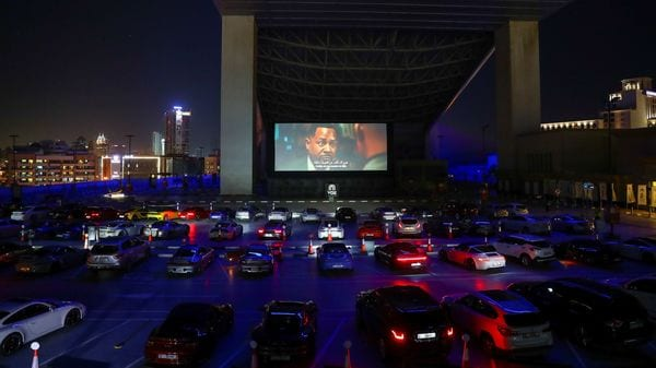 People sit in their cars watching a movie in a drive-in cinema at the Mall of the Emirates, following the outbreak of the coronavirus disease (COVID-19), in Dubai, United Arab Emirates, May 13, 2020. REUTERS/Ahmed Jadallah (REUTERS)
