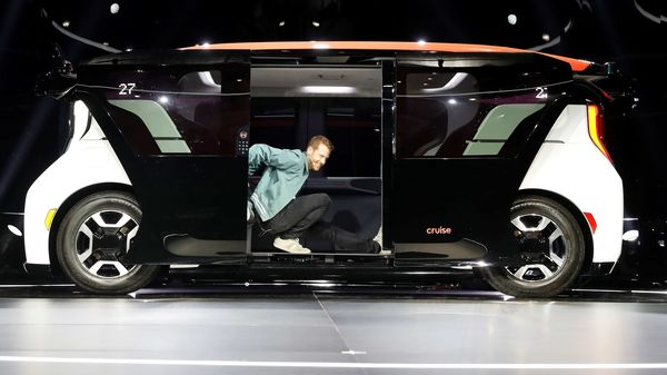 FILE PHOTO: Kyle Vogt, chief technology officer, president & co-founder of Cruise, a Honda and General Motors self-driving car partnership, stretches from a Cruise Origin autonomous vehicle during its unveiling in San Francisco, California, U.S. January 21, 2020. (REUTERS)
