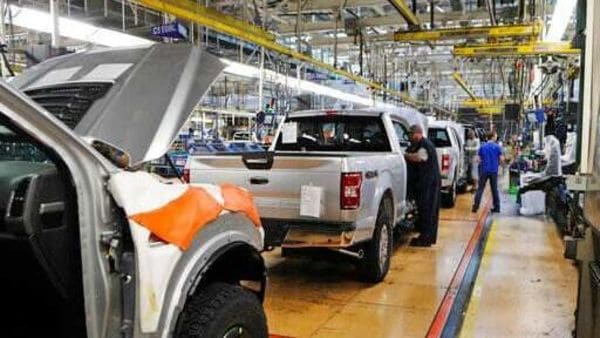 File photo: United Auto Workers assemblymen work on a 2018 Ford F-150 trucks being assembled at the Ford Rouge assembly plant in Dearborn, Mich. (AP)