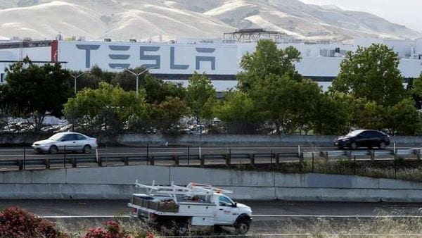 FILE PHOTO: Motorists drive past Tesla's primary vehicle factory in Fremont, California. (REUTERS)